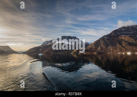 Greenland. Scoresby Sund. Milne Land. Small icebergs and rocky mountains. - Stock Image