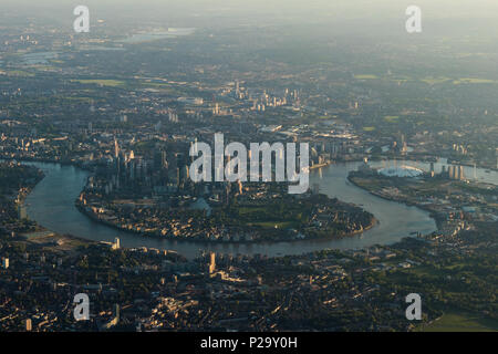 Early morning aerial view of the River Thames and Canary wharf, London from the south. - Stock Image