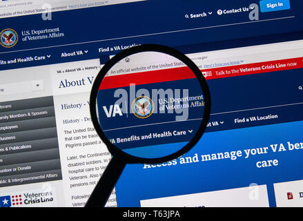 MONTREAL, CANADA - APRIL 24, 2019 : va.gov USA Government home page under magnifying glass. Va.gov is the official web site of US Department of Vetera - Stock Image