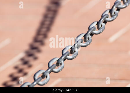 old metal chain on background with shadow - Stock Image
