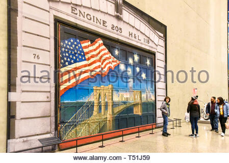 Inside of the National September 11 (9/11) Memorial and Museum. Door painted in tribute to fallen firefighters of the Engine 205 and Ladder 118 compan - Stock Image