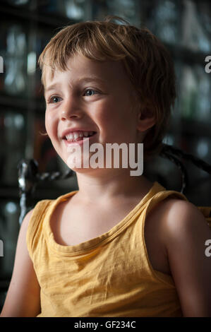 A 4-year-old boy reacts while he watches a cartoon on a computer screen at home.    [MR: Sean Pablo Saez O'Donoghue] - Stock Image