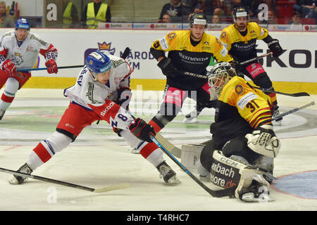 Karlovy Vary, Czech Republic. 18th Apr, 2019. (L-R) Rudolf Cerveny and David Tomasek of Czech Republic, Stefan Loibl, Niklas Treutle and Marco Nowak of Germany in action during the Euro Hockey Challenge match Czech Republic vs Germany in Karlovy Vary, Czech Republic, April 18, 2019. Credit: Slavomir Kubes/CTK Photo/Alamy Live News - Stock Image