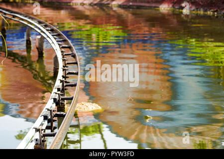 Roller Coaster Track near station on the lake - Stock Image