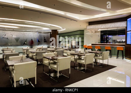United Arab Emirates, Abu Dhabi Airport, Terminal 3, Business Class Lounge, dining area tables - Stock Image