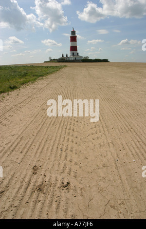 Happisburgh Lighthouse and field North Norfolk East Anglia England UK - Stock Image