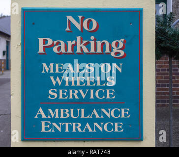parking restriction sign for meals on wheels service. - Stock Image