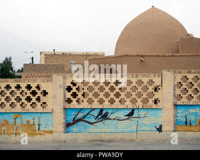 Historic adobe building surrounded by a painted wall, Meybod, Iran - Stock Image