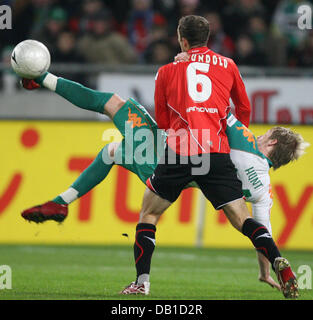 Steven Cerundolo (front) of Hanover vies for the ball with Aaron Hunt of Bremen during the Bundesliga match Hanover - Stock Image