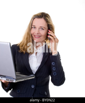 Smiling European business women with laptop and cell phone isolated on white - Stock Image