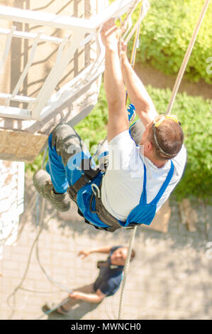 Industrial climber at work - Stock Image