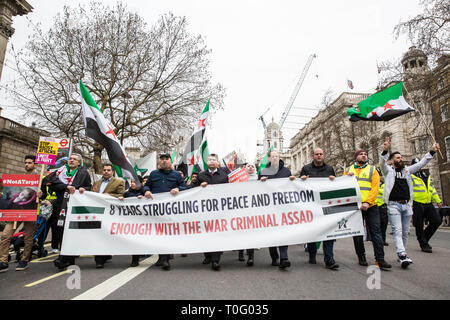 London, UK. 16th March, 2019. Members of the Syrian community opposed to President Assad march in Whitehall to mark the 8th anniversary of the start o - Stock Image