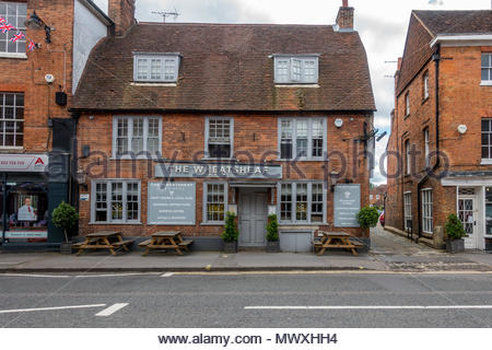The exterior of the Wheatsheaf a public house in the High Street, Farnham, Surrey UK - Stock Image