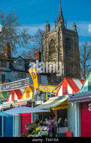 Colourful market stalls of Norwich city market with St Peter Mancroft Church to the rear. Norfolk, East Anglia, England, UK. - Stock Image
