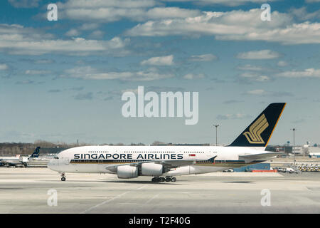 New York, 3/17/2019: Singapore Airlines commercial jet is maneuvering on the tarmac at JFK airport. - Stock Image