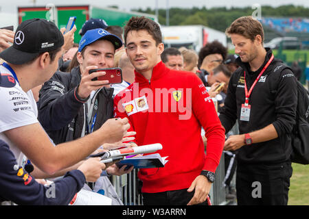 Silverstone, UK. 14th July, 2019.  FIA F1 Grand Prix of Britain, Race Day; Scuderia Ferrari driver Charles Leclerc stops for a photo Credit: Action Plus Sports Images/Alamy Live News - Stock Image