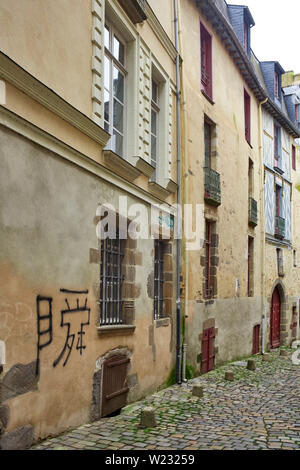 A narrow cobbled street with older buildings in Rennes, the capital of Brittany, France - Stock Image
