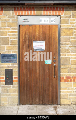Public unisex and disabled toilet with out of order notice on door - Stock Image