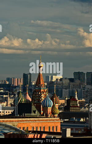 MOSCOW, AUGUST 7, 2018: Beautiful view of Moscow city and St. Basil's cathedral at summer sunset. New tall residential buildings in the background. Ve - Stock Image