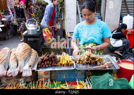 Street vendor selling snacks and fish In Yangon Myanmar (Burma) - Stock Image