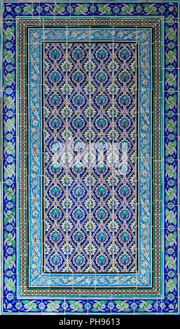 Ottoman style glazed ceramic tiles decorated with floral ornamentations manufactured in Iznik, Turkey - Stock Image