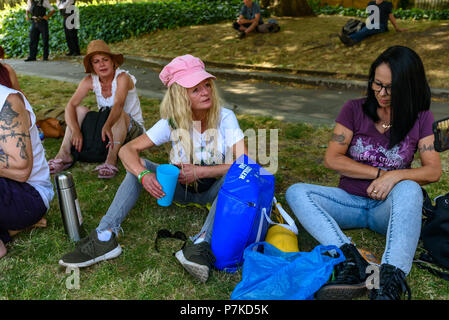 London, UK. 6th July 2018. Members of the group 'We The Undersigned Have a Legal Right to use Cannabis' rest at the protest in Old Palace Yard in support of Newport West Labour MP Paul Flynn's Private Member's Bill to allow the medical use of cannabis was expected to be debated this afternoon.  They tell reporters of how they need cannabis for their various health problems. Objections by MPs prevented the debate and it was pushed back until October. Credit: Peter Marshall/Alamy Live News - Stock Image