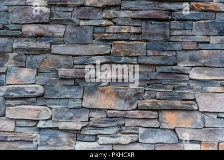 Gray and Brown Stacked Stone Wall Background Image - Stock Image