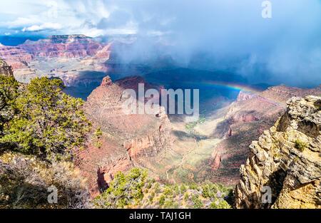 Rainbow above the Grand Canyon in Arizona, USA - Stock Image