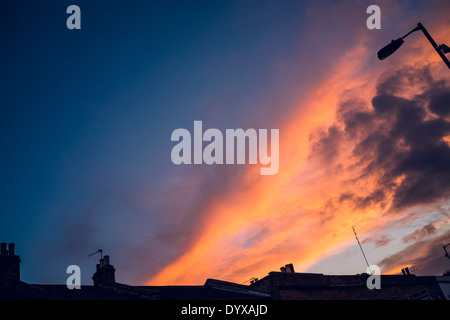View of the London sky in a sunset with victorian houses' chimneys. - Stock Image