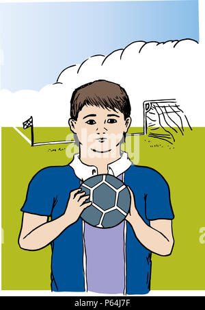 Young football player.  Football player child holding ball in front of football field. - Stock Image