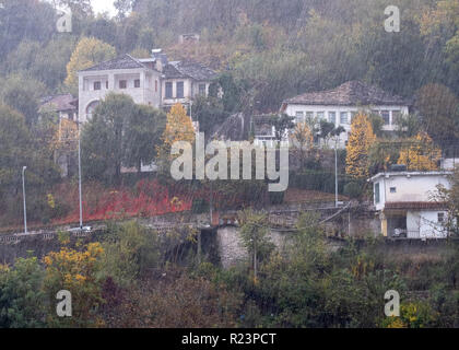 Gjirokaster, Albania, October 30, 2018. View of residential area of city below the castle in pouring rain that created flooding - Stock Image
