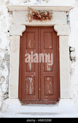 Wood door of an Orthodox Church in Paros, Greece - Stock Image