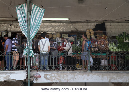 Customers shop for fruit and vegetables at the Mercado do Bolhão fresh produce market in Porto. (Photo by Dominic - Stock Image