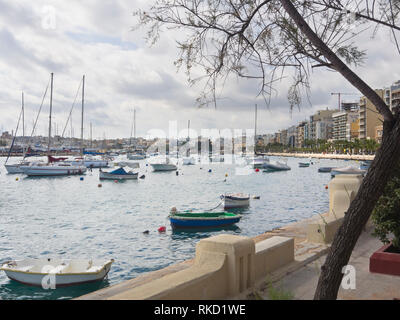 Seafront promenade in the Sliema district near Valetta in malta, sunny and inviting for a morning walk - Stock Image