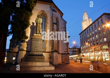 Switzerland Zurich statue Zwingle statue in front of water church Grossmuenster - Stock Image
