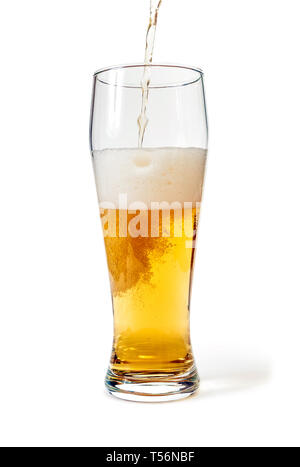 Pint glass filled with beer isolated with clipping path. Focus on bubbles - Stock Image