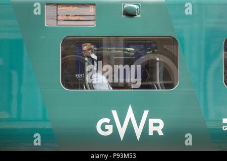 A male passenger waiting to depart on a Hitachi Class 800 Intercity Express locomotive train at Paddington Station, London, UK - Stock Image