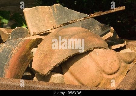 broke broken cotta metal planters pots rust rusting shattered steel terra terracotta - Stock Image