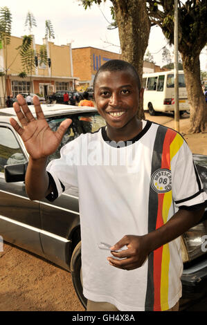 geography / travel, Rwanda, young one man with German football shirt beckon in the camera, Butare, Additional-Rights - Stock Image