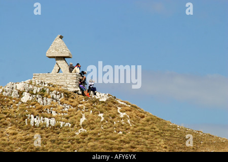hikers relax near Pintura on  Sasso Tetto  mountain in the Sibillini National Park,Le Marche Italy - Stock Image