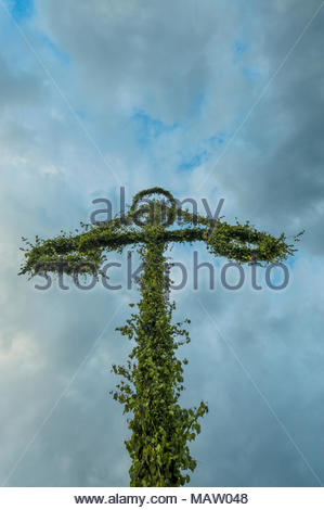 Magic midsummer in Sweden.Summer solistice used to be a pagan holiday in Sweden, but now it is a celebration of light, maypole and food. - Stock Image