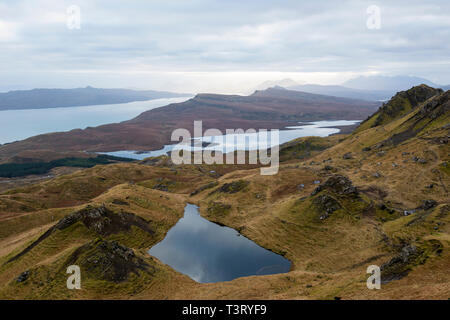 Lochan on the Trotternish ridge, with view across Loch Leathan and the Sound of Raasay, Isle of Skye, Highland Region, Scotland, UK - Stock Image