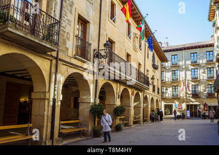 Laguardia, Álava province, Basque Country, Spain : A woman walks past the townhall at Plaza Mayor square in the historic town of Laguardia in the Rioj - Stock Image