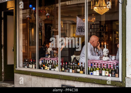 Man By The Window Stockholm Sweden - Stock Image