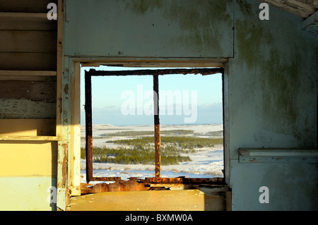 Winter view out the window of an old derelict shieling on the Isle of Lewis in the Western Isles - Stock Image