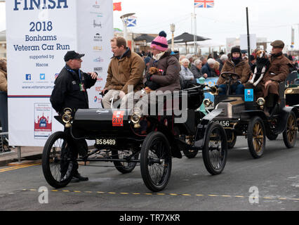 Mr  Ben  Portus being interviewed, after completing the 2018 London to Brighton Veteran Car Run  in a  1903 Oldsmobile - Stock Image