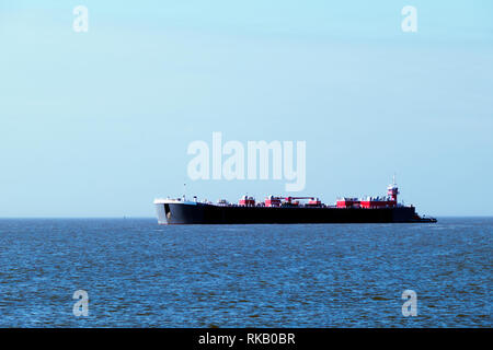 Bouchard barge #295 sits at the mouth of Mobile Bay in the shipping channel after being retrofitted and updated with new technologies. - Stock Image