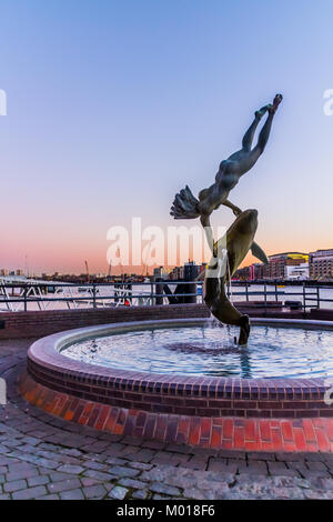 Girl with dolphin statue, River Thames, London. - Stock Image