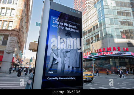 A photo on a LINKNYC screen advertising a Jackie Robinson photo exhibit at the Museum of the City of New York to commemorate his 100th birthday. - Stock Image