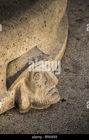 Stone Scandinavian head and face sculpture on outdoor seating, Stockholm, Sweden - Stock Image